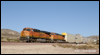 ES44C4 6604 leads auto carriers down Cajon Pass at MP58, 2010