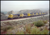 B23-7 6385 leads a mix of eight GP30s and GP35s upgrade through light snowfall near MP57, Cajon Pass, CA, 1993