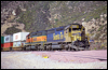 SD45-2 5857 and H1 SD40-2 6954 help an eastbound at Cajon, CA, 2000