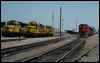 GP9 2271 rests beside GP20 3021 while a set of GP60Ms prepares to make a stop.  San Bernardino, CA, 1990