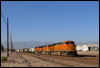 ES44DC 7703 leads an M BARSDG with Santa Fe S2 2381 tucked in six cars back on a flat car. The Alco switcher is bound for the Pacific Southwest Railway Museum in Campo, CA • Rana, CA, 2007