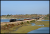 Santa Fe 3751 pulls the American Association of Private Railroad Car Owners (AAPRCO) special across Batiquitos Lagoon, in Carlsbad, CA, on its southbound run to Old Town, San Diego · 2008