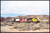 SD40-2 5045 and GP60M 109 assist a train descending Cajon Pass about a mile west of Summit, CA, 1994