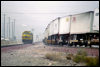 SDF40-2 5265 • Santa Fe helpers drift down the South Track while an eastbound TOFC hustles up the North Track at Cajon, CA, 1995