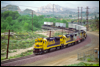 Dash 8-40B 7420 leads TOFC down the South Track at Cajon, CA, 1994