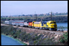 On April 23, 1987, an Operation Lifesaver special rolls across a fill through the Batiquitos Lagoon in Carlsbad as the train makes its way toward San Diego. Santa Fe FP45 5998 pilots Union Pacific E9 951, Southern Pacific SDP45 3201, Amtrak F40PH 240 and a mix of passenger cars.