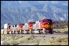 BNSF 8256 leads a quartet of SD75M/Is passing Milepost 58X, Cajon Pass, CA, 2001