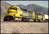 ATSF 5810 trails a pair of 5800-class SD45-2 helpers assisting a westbound intermodal down the North Track at Cajon, CA, 1991