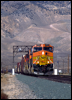 BNSF 4523 east nears Union Pacific's Mojave, CA,  yard in 2002
