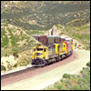 Autoracks led by SD45-2 5841 approaches Cajon Summit, CA, 1997