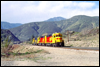 Kodachrome GP30 2752, GP39-2 3613 and a Yellowbonnet GP38 eastbound at Swarthout Canyon Road in Cajon Pass, CA, 1987