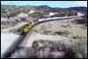 Class GP60 4000 on the point of a westbound TOFC near MP57 in Cajon Pass, CA, 1989