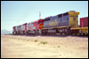 SD45-2B 5517 trails a couple of Dash 8s and an FP45 at Hesperia, CA, 1993